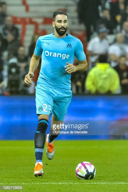 Adil Rami of Olympique de Marseille runs with ball during the Ligue 1 match between OGC Nice and Olympique de Marseille at Allianz Riviera Stadium on...