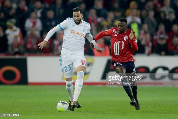 Adil Rami of Olympique Marseille Nicolas Pepe of Lille during the French League 1 match between Lille v Olympique Marseille at the Stade Pierre...