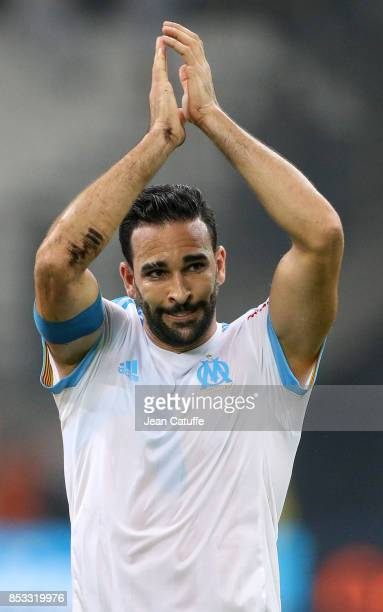 Adil Rami of OM celebrates the victory following the French Ligue 1 match between Olympique de Marseille and Toulouse FC at Stade Velodrome on...