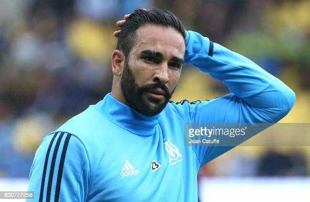 Adil Rami of OM warms up during the French Ligue 1 match between FC Nantes and Olympique de Marseille at Stade de la Beaujoire on August 12 2017 in...