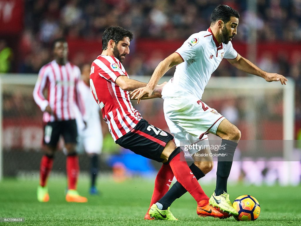 Adil Rami of Sevilla FC (R) being followed by Raul Garcia of Athletic Club (L) during the La Liga match between Sevilla FC and Athletic Club de Bilbao at Estadio Ramon Sanchez Pizjuan on March 02, 2017 in Seville, Spain.