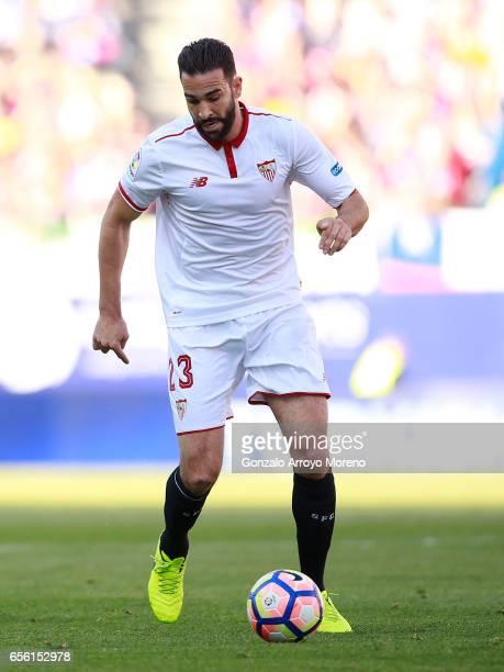 Adil Rami of Sevilla FC controls the ball during the La Liga match between Club Atletico de Madrid and Sevilla FC at Vicente Calderon stadium on...