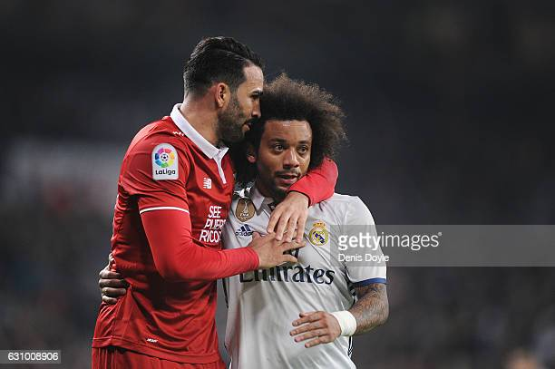 Adil Rami of Sevilla FC reacts with Marcelo of Real Madrid after he stopped Marcelo's attack during the Copa del Rey Round of 16 First Leg match...