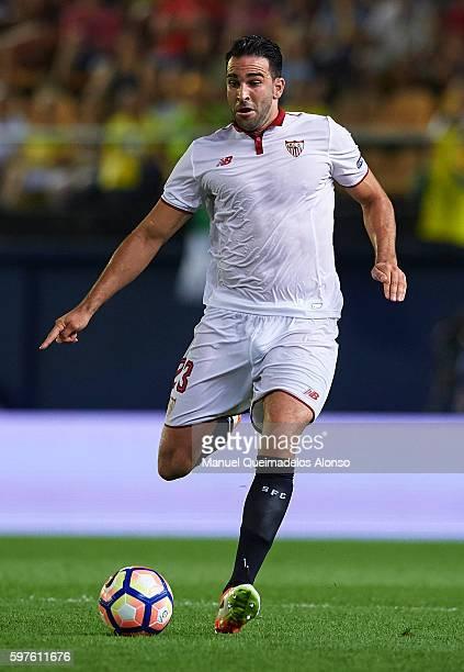 Adil Rami of Sevilla runs with the ball during the La Liga match between Villarreal CF and Sevilla FC at El Madrigal on August 28 2016 in Villarreal...