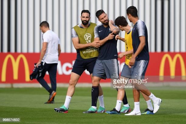 Adil Rami Olivier Giroud Benjamin Pavard and Raphael Varane joke during a France training session during the 2018 FIFA World Cup at Luzhniki Stadium...