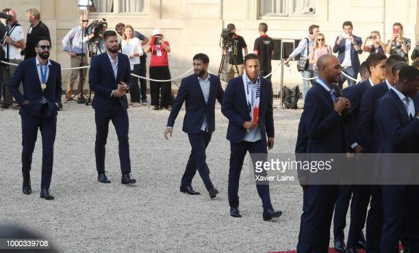 Adil Rami Olivier Giroud Nabil Fekir and Corentin Tolisso arrive at a reception for France's national football team at Elysee Palace on July 16 2018...