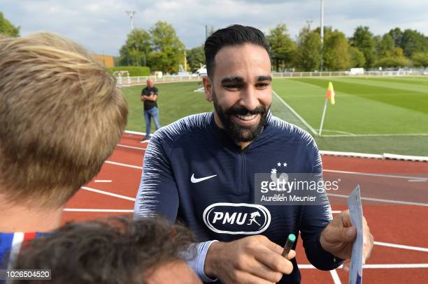 Adil Rami signs autographs as he arrives for a French Soccer team training session on September 3 2018 in EtivalClairefontaine France