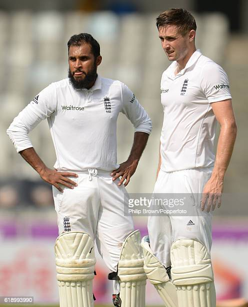 Adil Rashid and Chris Woakes during the second day of the second test match between Bangladesh and England at Shere Bangla National Stadium on...