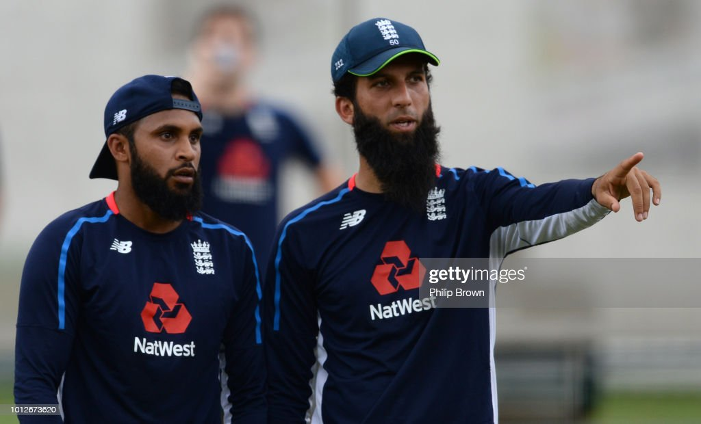 Adil Rashid and Moeen Ali of England look on during a training session before the 2nd Specsavers Test Match between England and India at Lord's Cricket Ground on August 7, 2018 in London England.