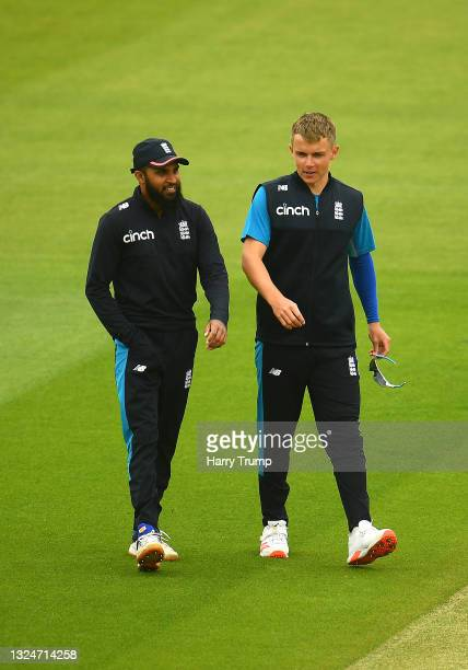 Adil Rashid and Sam Curran England look on during an England Nets Session at Sophia Gardens on June 21, 2021 in Cardiff, Wales.