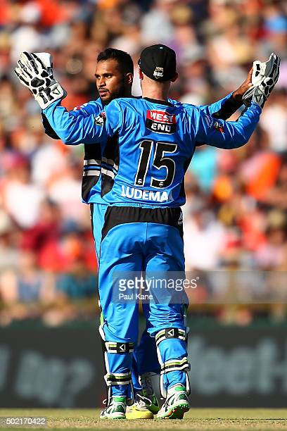 Adil Rashid and Tim Ludeman of the Strikers celebrate the wicket of Mitch Marsh of the Scorchers during the Big Bash League match between Perth...