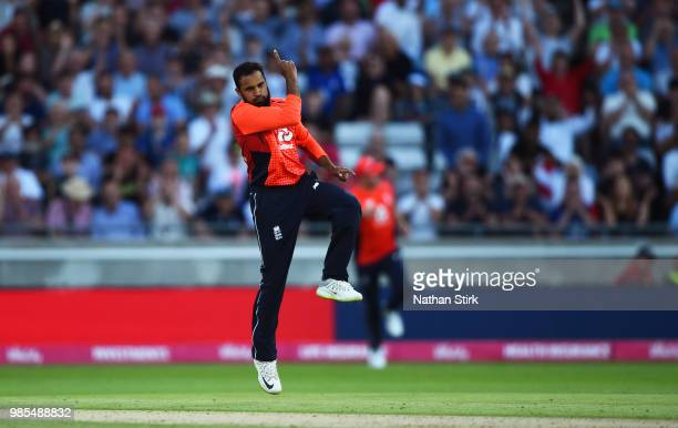 Adil Rashid celebrates after getting Alex Carey of Australia out during the 1st Vitality International T20 match between England and Australia at...