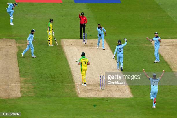 Adil Rashid of England and his team mates celebrate taking the wicket of Marcus Stoinis of Australia during the Semi-Final match of the ICC Cricket...