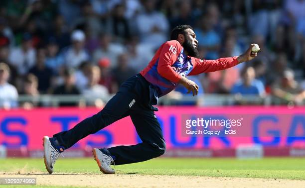 Adil Rashid of England catches out Mohammad Rizwan of Pakistan from his own bowling during the Second Vitality International T20 match between...