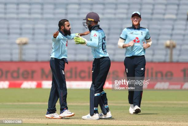 Adil Rashid of England celebrates after taking the wicket of Rohit Sharma of india with team mates Jos Buttler and Ben Stokes during the 3rd One Day...