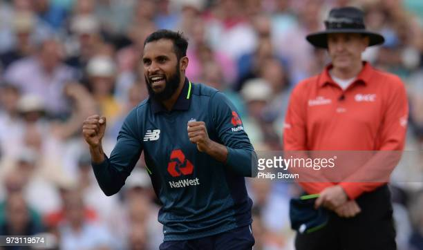 Adil Rashid of England celebrates after the dismissal of Marcus Stoinis during the first Royal London OneDay International match between England and...