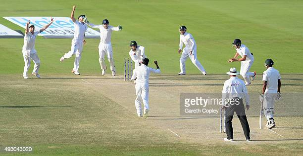Adil Rashid of England celebrates dismissing Imran Khan of Pakistan during day five of the 1st Test between Pakistan and England at Zayed Cricket...