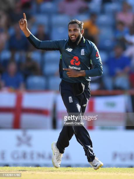 Adil Rashid of England celebrates dismissing West Indies captain Jason Holder during the 4th One Day International match between the West Indies and...