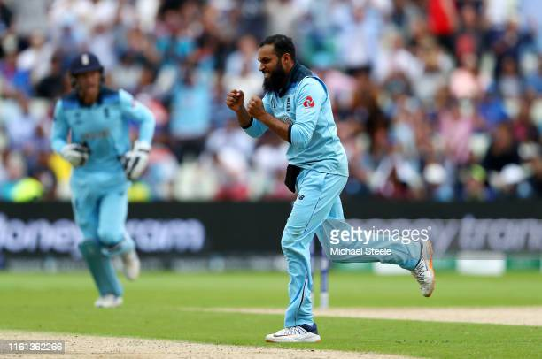 Adil Rashid of England celebrates taking the wicket of Alex Carey of Australia during the Semi-Final match of the ICC Cricket World Cup 2019 between...