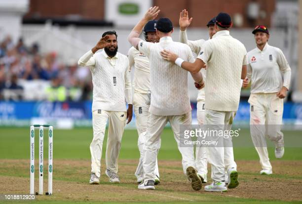 Adil Rashid of England celebrates teammates after dismissing India captain Virat Kohli during the Specsavers 3rd Test match between England and India...