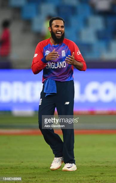 Adil Rashid of England celebrates the wicket of Obed McCoy of West Indies with team mate Eoin Morgan during the ICC Men's T20 World Cup match between...