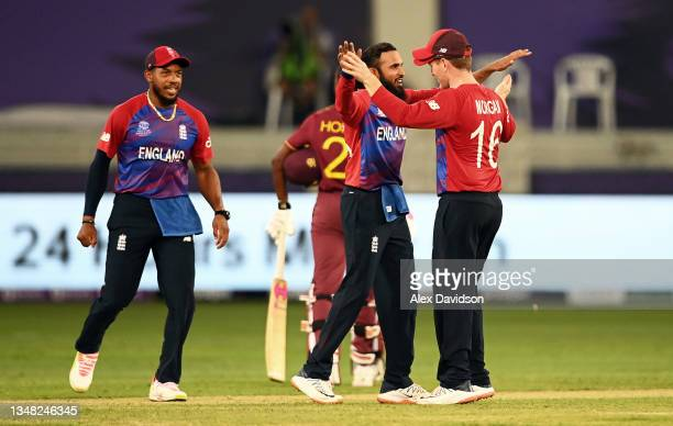 Adil Rashid of England celebrates the wicket of Ravi Rampaul of West Indies with team mate Eoin Morgan during the ICC Men's T20 World Cup match...