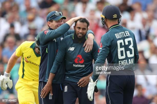 Adil Rashid of England celebrates with captain Eoin Morgan and Jos Buttler after dismissing Ashton Agar of Australia during the 1st Royal London ODI...