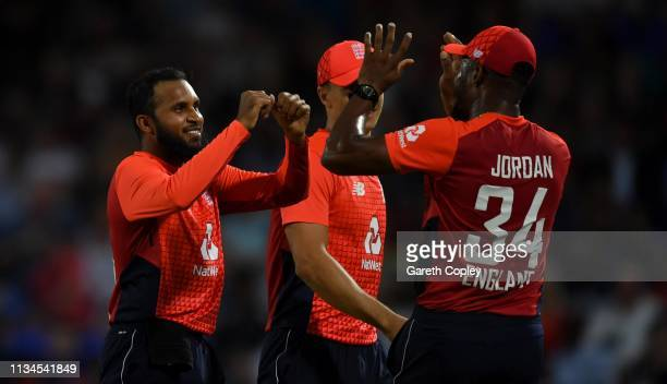 Adil Rashid of England celebrates with Chris Jordan after dismissing Carlos Brathwaite of the West Indies during the 2nd Twenty20 International match...