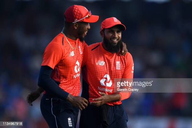 Adil Rashid of England celebrates with Chris Jordan after dismissing Obed McCoy of the West Indies during the 3rd Twenty20 International match...