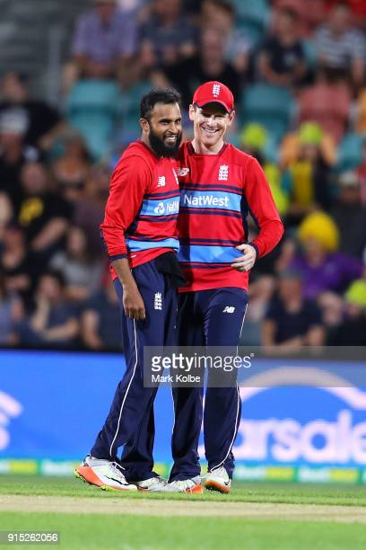 Adil Rashid of England celebrates with Eoin Morgan of England after taking the wicket of D'Arcy Short of Australia during the Twenty20 International...