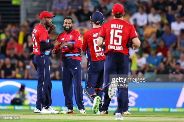 Adil Rashid of England celebrates with his team mates after taking the wicket of D'Arcy Short of Australia during the Twenty20 International match...