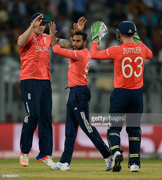Adil Rashid of England celebrates with Jason Roy and Jos Buttler after dismissing Marlon Samuels of the West Indies during the ICC World Twenty20...