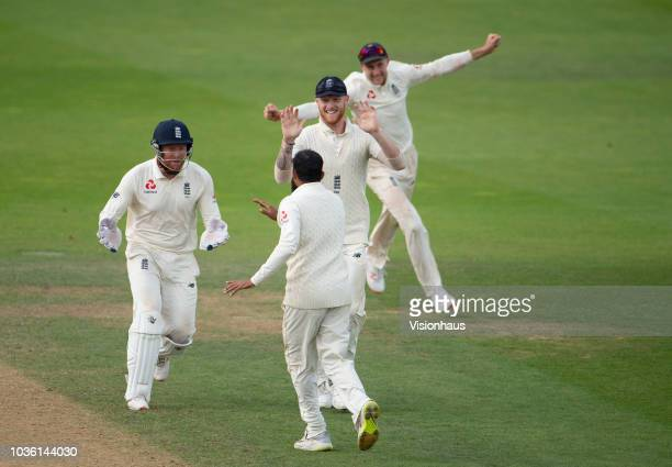 Adil Rashid of England celebrates with Joe Root, Jonny Bairstow and Ben Stokes after taking the wicket of Rishabh Pant of India during the 5th...