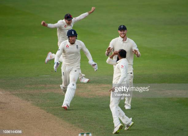 Adil Rashid of England celebrates with Joe Root Jonny Bairstow and Ben Stokes after taking the wicket of Rishabh Pant of India during the 5th...