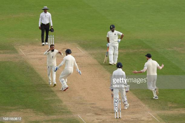 Adil Rashid of England celebrates with Jonny Bairstow after dismissing Rishabh Pant of India during the Specsavers 5th Test Day Five between England...