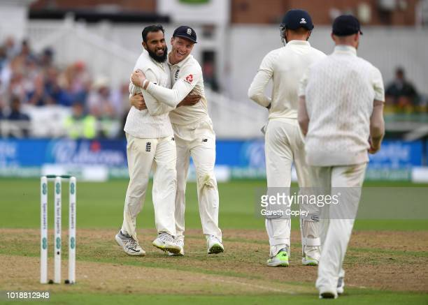 Adil Rashid of England celebrates with Jos Buttler after dismissing India captain Virat Kohli during the Specsavers 3rd Test match between England...