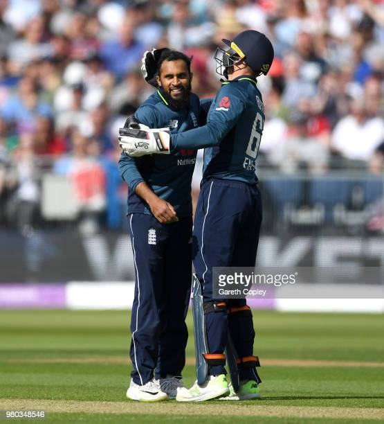 Adil Rashid of England celebrates with Jos Buttler after dismissing Ashton Agar of Australia during the 4th Royal London One Day International...