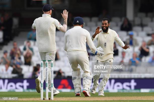 Adil Rashid of England celebrates with Keaton Jennings and Jonny Bairstow after dismissing Rishabh Pant of India during the Specsavers 5th Test Day...