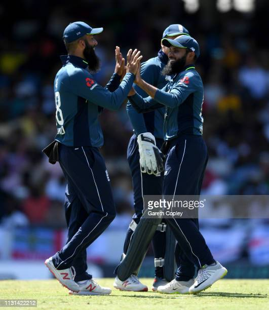 Adil Rashid of England celebrates with Moeen Ali after running out Darren Bravo of the West Indies during the 2nd One Day International match between...