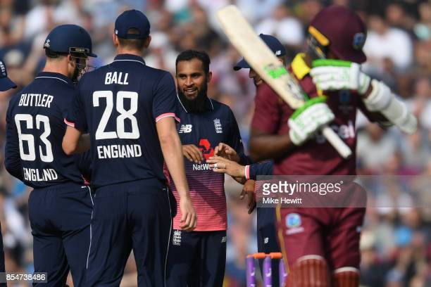 Adil Rashid of England celebrates with team mates after dismissing Jason Mohammed of West Indies during the 4th Royal London One Day International...