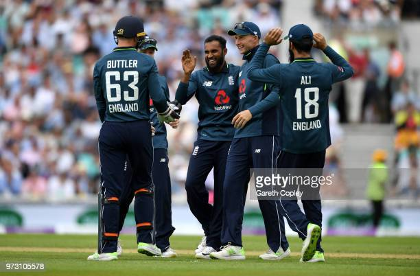 Adil Rashid of England celebrates with teammates after dismissing Marcus Stoinis of Australia during the 1st Royal London ODI match between England...