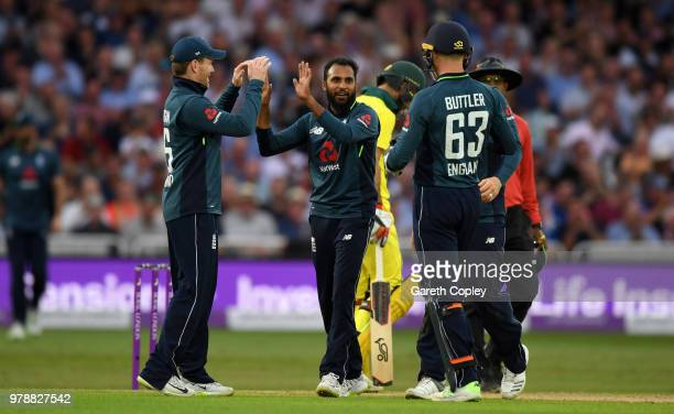 Adil Rashid of England celebrates with teammates Eoin Morgan and Jos Buttler after dismissing Tim Paine of Australia during the 3rd Royal London ODI...