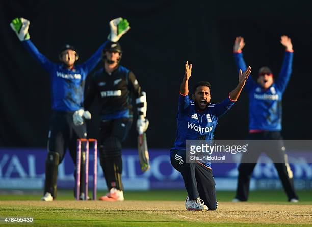 Adil Rashid of England claims the wicket of Matt Henry of New Zealand during the 1st ODI Royal London OneDay Series 2015 match between England and...