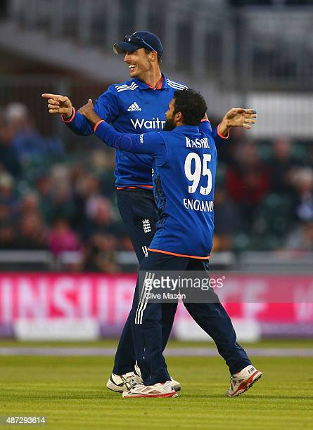 Adil Rashid of England congratulates Steven Finn of England on his catch to dismiss Steve Smith of Ausralia during the 3rd Royal London OneDay...