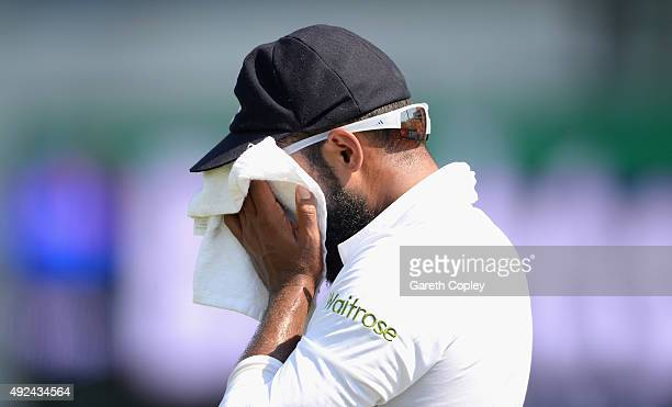 Adil Rashid of England feels the heat during the 1st Test between Pakistan and England at Zayed Cricket Stadium on October 13 2015 in Abu Dhabi...