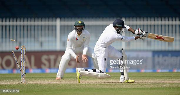Adil Rashid of England is bowled by Rahat Ali of Pakistan during day five of the 3rd Test between Pakistan and England at Sharjah Cricket Stadium on...