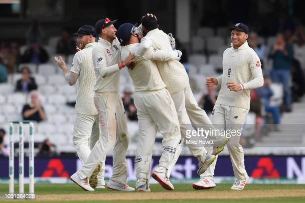 Adil Rashid of England is lifted off his feet by Jonny Bairstow after dismissing Rishabh Pant of India during the Specsavers 5th Test Day Five...