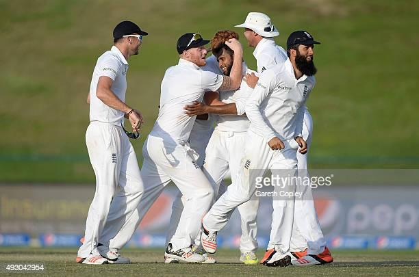 Adil Rashid of England is mobbed by teammates after dismissing Imran Khan of Pakistan during day five of the 1st Test between Pakistan and England at...