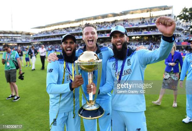 Adil Rashid of England Jos Buttler of England and Moeen Ali of England celebrate after winning the Cricket World Cup during the Final of the ICC...