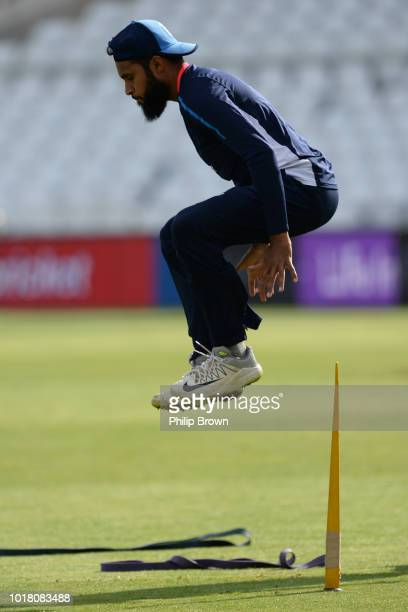Adil Rashid of England leaps during a training session before the 3rd Specsavers Test Match between England and India at Trent Bridge on August 17...